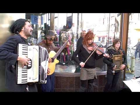 east european music - This was shot around xmas of 2010, when telegraph avenue is closed to automobiles, and becomes a street fair atmosphere for a couple of weeks. These kids loo...
