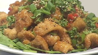 "This video demonstrates a Chinese approach to frying large squid bodies.  The use of sweet soy sauce, ginger, garlic, scallions, broccoli and sesame make this preparation an absolute standout among fried calamari preparations.  I utilize U-10 (less than 10 bodies to a pound) squid bodies and demonstrate how to tenderize them and prepare them for the fryer.  The cook may also choose to cut the squid into strips but I prefer the larger pieces as demonstrated here.  Although the word ""Calamari"" is Italian for squid I've chosen to call this Chinese style preparation ""Calamari"" so that it can be easily identified and referenced by mainstream diners and cooks."