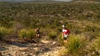2012 Bandera 100 km Trail Run.Midway through each 50km loop you run up and down three hills called the 3 sisters. Here are the male leaders working up the first climb.I was trying to take pictures with a camera and shoot some video at the same time...not the best decision. :)For more trail and ultra running fun, check out EnduranceBuzz.com