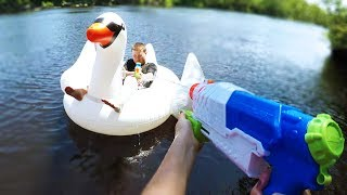 In this epic Nerf war, Anna and James use Nerf Super Soaker blasters to battle! We do turns of crazy things in this fight like jumping off cliffs and bridges as well as riding a giant inflatable swan! FOLLOW ME ON SOCIAL MEDIAInstagram: http://instagram.com/annakouskyTwitter: http://twitter.com/annakousky----------------------------------------------------------------~ About Goober Media ~My name is Anna Kousky and I'm the director of Goober Media. I film all kinds of awesome Nerf Wars with my siblings.I'm currently in high school and I put a lot of effort into producing at least one NEW video every Saturday! When I'm not filming I'm either playing soccer, snowboarding, or eating a nice juicy piece of fruit (I love fruit haha). I come from a big family and have 6 other siblings! It's crazy fun. My brother Paul owns the famous Nerf channel PDKfilms, and I act in a lot of his Nerf videos as well. Here's a list of all my brothers and sisters so you can get to know the fam... Chad, Paul, Eric, Anna (me), James, Chris, and Eva. Most of my Nerf content consists of Nerf First Person Shooters, Funny and Intense Nerf Wars, and plenty of unique Nerf battles that I'm sure you'll love. Enjoy my friends, and Subscribe to Goober Nation!----------------------------------------------------------------------------