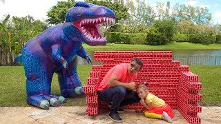 Stacy and Dad play with dinosaur