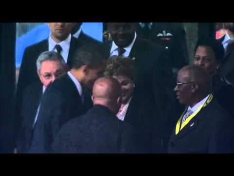 raw - President Barack Obama shook hands with Cuban President Raul Castro Tuesday at a memorial service for Nelson Mandela, a simple gesture that stoked talk of a ...