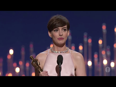 Supporting - Christopher Plummer presenting Anne Hathaway with the Oscar® for Best Supporting Actress for her performance in 