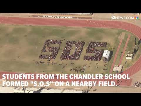 Hamilton High School students form SOS during walkout
