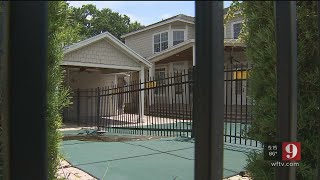 Video:Property owner builds fence through pool