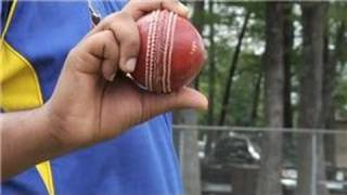 An off spin delivery can be accomplished by gripping the ball in a very specific way. Bowl an off spin delivery in cricket with help from the President of th...