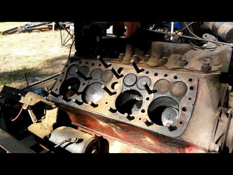 Ford Flathead V8 running with one head removed.