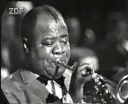 Louis Armstrong performing his hit Hello Dolly on a stage
