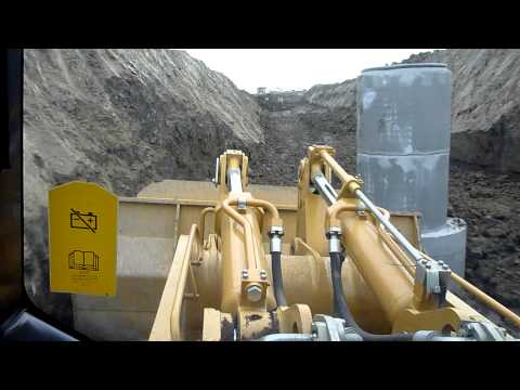 Cat 973C Cutting Around Manhole