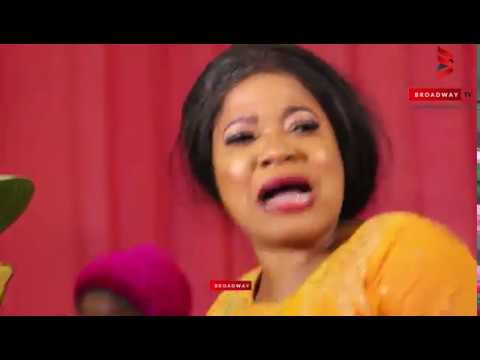 Toyin Abraham Dances In A Pile Of Cash At Her Dad's Final Burial Celebration
