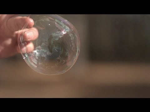 Bubble Bursting in Extreme Slow Motion
