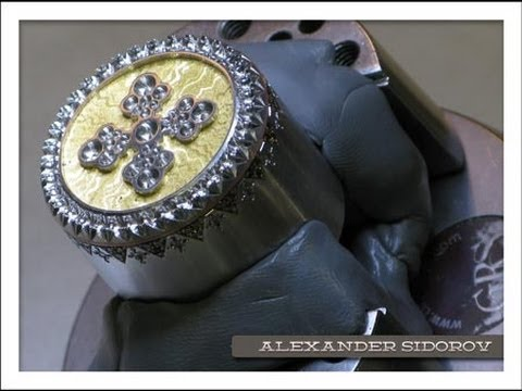 [Production] Jeweler creates a piece and sets diamonds in it.