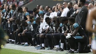 NFL players protest during the US national anthem at Wembley