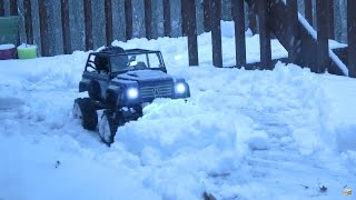 RC Snow plowing! I Finally got enough snow to try out my RC snow plow truck build, and it worked very well!The RC snow plow in this video is from RCmart- http://bit.ly/snowPlow_forSCX10_XtraSpeed_rcMartThe snow plow Is made for an axial SCX10 4x4 truck. The plow mounts firmly to the chassis by using 4 screws. A servo on a 3rd channel of your radio is used to raise and lower the plow via a small length of chain. The rc snow tracks used in the video are also from RCmart- http://bit.ly/TerrainTracks_For_SCX10_XtraSpeed_rcMartThese tracks are awesome! They provide a whole new RC experience!If you want to plow snow with your RC, you are going to need 4wd, a snow plow, snow chains or all terrain tracks, and the heavier the truck the better in this situation.My kitten loves RC snow plowing too! lol watch him stare at the RC in amusement!The RC truck in this video is an Axial SCX10 4x4 with snow tracks, a snow plow, all waterproof electronics, and dual motors!#snow #snowplow #rctrucks #axial #rcvideos #rc #hobby #fun #kittenMusic- Disco Medusae Kevin MacLeod (incompetech.com)Licensed under Creative Commons: By Attribution 3.0 Licensehttp://creativecommons.org/licenses/by/3.0/