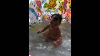 Elise playing in the water