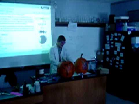Cameron Hall blows up his pumpkin