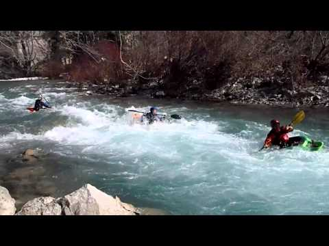 River running with playboating kayaks.MP4