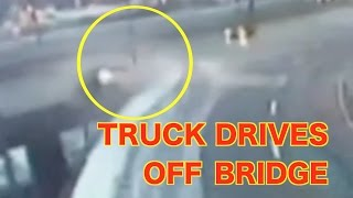 "http://viralquickies.comTraffic cameras captured an incredible event as a drunk man drives his truck off a bridge in Boston. The driver behind the wheel of a pickup truck that plunged off the upper deck of the Zakim Bridge admitted to drinking before the crash and being irresponsible.Vannak Sao, 33, said he had been out at a bar Saturday night and then had a few drinks at a friend's house before he drove home. He remembered feeling drowsy and striking the snow bank, but not the fall itself.State police said Sao struck a barrier and crashed through a fence before he fell off the upper deck, landing southbound on Route 93. Boston and Somerville firefighters helped him out of the truck and transported him to Mass General.Sao escaped with a fractured nose, stitches above his eye and some bruising and said he is grateful to be alive. Sao said he is relieved there was not another car down below.""That's part of the reason why I don't know how to feel right now,"" said Sao. ""Because if someone else was hurt, that's not a good feeling to have.""Troopers determined Sao was under the influence and he will be summonsed to court for driving under the influence and negligent operation of a motor vehicle. Sao said he is owning up to the crash and is ready to face the punishment for it.https://www.facebook.com/viralquickiespagehttp://www.twitter.com/viralquickiesVisit our blog: http://viralquickies.blogspot.com  Viral Quickies backup channel: http://www.youtube.com/user/ViralQuickiesVideosOfficial Site: http://www.viralquickies.com"