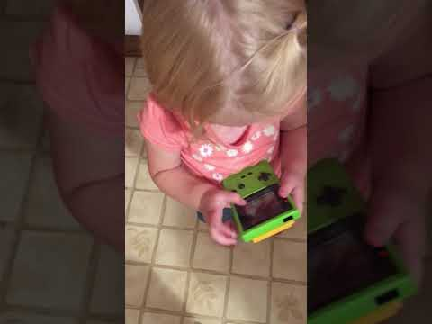 Little Girl Attempts to Play Classic Game Boy by Touching the
