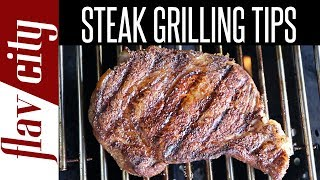 I'm showing tips for grilling steaks at home because a lot of you guys have been asking how to grill the perfect steak. This video is a collaboration with Beef. It's What's For Dinner on behalf of the Beef Checkoff. #KingOfTheGrill #adMore summer grilling tips: http://www.beefitswhatsfordinner.com/#utm_source=cooking-styles-influencer-activation-bobby-flav-city&utm_campaign=cooking-styles-influencer-activationRecipe For the Ribeye Steak:1 thick cut boneless ribeye steak, at least 1.25 inches thick1 teaspoon smoked paprika1 teaspoon ancho chile powder1 teaspoon ground cuminKosher saltCook's notes:I like to use a steak that is 1.5 inches thick, you can also use a bone-in ribeye steak also. When cooking thick steaks, you really want to use a digital probe or instant read thermometer. It;s really hard to guess the doneness of a thick steak. Begin Cooking:Make the spice rub by adding the paprika, cumin and ancho powder to a small bowl, mix well. Season the steak with a generous pinch of salt and spice rub on both sides of the steak and on the sides. Let sit in the fridge for 15-25 minutes. You can marinate up to two hours, but don;t add the salt until right before you grill the steak otherwise it might pull out too much juice. Pre-heat one side of your charcoal or gas grill to to medium-high heat and the other side to medium-low heat for 10-20 minutes so it;s nice and hot. Place the ribeye steak on the hot zone of the grill and press the meat down so it makes maximum contact with the grill. Cook for 3-5 minutes, or until really nice grill marks form, flip and repeat on the other side. Move the steak to the cooler side of the grill, and close the lid. Cook for 3 minutes, flip, and cook another 3 minutes. Insert the thermometer through the side of the steak and push it all the way to the center. Keep cooking until the internal temperature it 140 degrees for medium rare. Remove from heat and allow the steak to rest 5-7 minutes t the juices can re-distribute. The internal temperature will rise another 5 degrees while the meat rests, so factor that into how you want your steak cooked. Slice the steak and enjoy!Recipe For the Strip Steak:1 thick cut strip steak,1 pound and at least 1.25 inches thick1 teaspoon sweet paprika1 teaspoon garlic powder1/2 teaspoon dried oregano1/4 teaspoon cayenne pepper Kosher salt Mix the spices together in a small bowl and follow the same instructions as for the ribeye steak. Enjoy!New Videos Every Friday!Follow Me On Social Media:Facebook: https://www.facebook.com/flavcityInstagram: https://www.instagram.com/flavcitySnapchat: flavcityTwitter: https://www.twitter.com/flavcityI'm out to prove that home cooks can be rock stars in the kitchen. I look forward to sharing my recipes & cooking style with you on my channel!Music from Audio Network