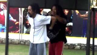 Damian Marley putting hair in backpack to play Soccer (GENIUS!)