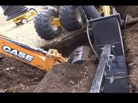 Case590 - CASE 590 SN backhoe digging out a rock after DK 628 trencher hit a rock, for a second time. See past three videos for reference - shows trencher modification...