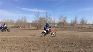 9. Honda crf150rb big wheel with an adult riding