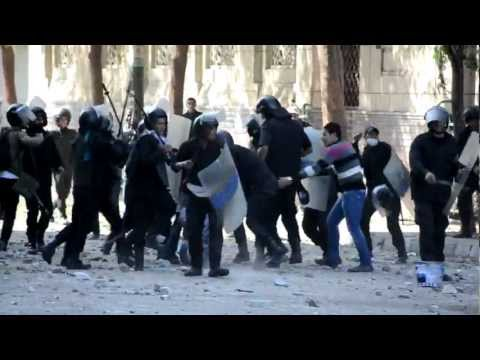 (in Arabic) Security forces attacking protestors, off Tahrir