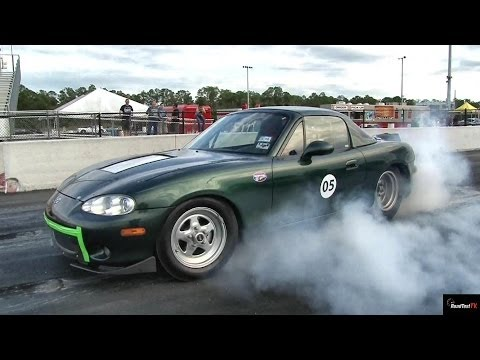 TESLA P85 Gets ZAPPED by Electric MIATA !!  – 1/4 mile Drag Race Video – Road Test TV
