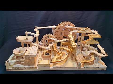 A Wooden Marble Machine Uses Gears and Lifts to Endlessly Push Marbles Down 3 Separate