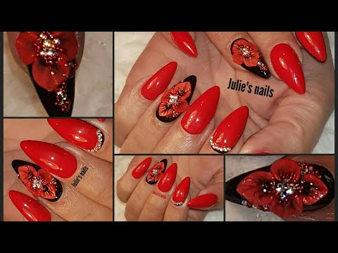 Red and black gel nails with 3D gel nail art
