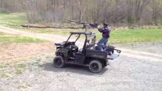 8. Shooting an M2 from the seat of a Polaris Ranger.