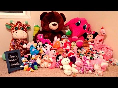 Purple Elf on the Shelf - Hiding in Stuffed Animals Pile - Sparkles Day 6