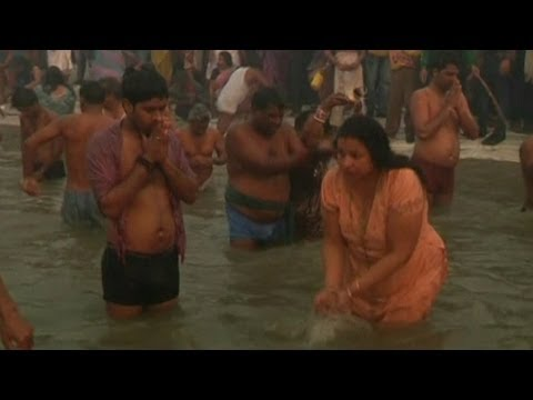 bathing in ganga - Millions of Hindus are arriving at Allahabad to bathe in the Ganges river for the Maha Kumbh Mela, billed as the world's largest religious festival. Near a m...