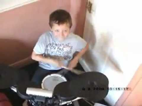 Conor Fletcher age 7 playing mustang sally by  the black rino band.wmv