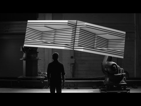 box - Box explores the synthesis of real and digital space through projection-mapping on moving surfaces. The short film documents a live performance, captured ent...