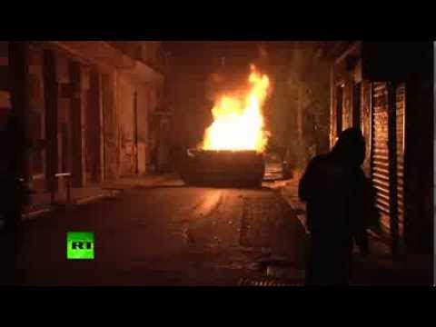 Video: Cops, cars on fire as protesters throw Molotov cocktails in Athens