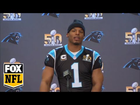 Snoop Dogg asks Cam Newton questions at press conference.