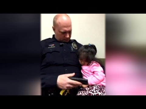 WATCH: Cop Babysits Strangers Toddler