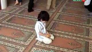 A Muslim Cute Kid Performing Salah [Prayer]