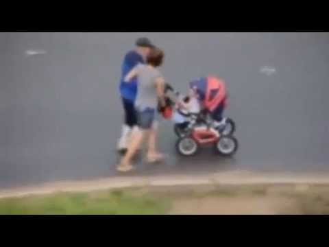 Shocking video of 'drunk' parents staggering across road as they push baby in buggy