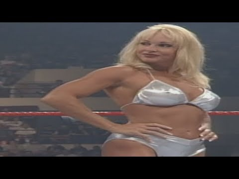 Debra - Debra in her sexy silver attire defends her Women's Title against arch nemesis Ivory, the final chapter of a bitter feud between the two women!