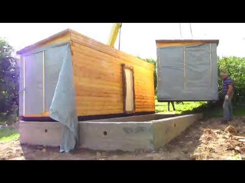 Установка и стыковка модулей деревянного дома из профилированного бруса