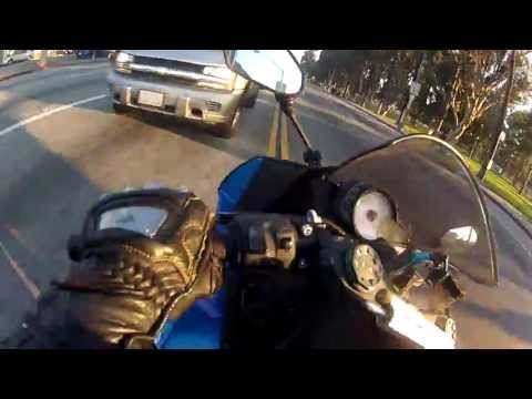 Motorcycle has a close call after running a yellow light