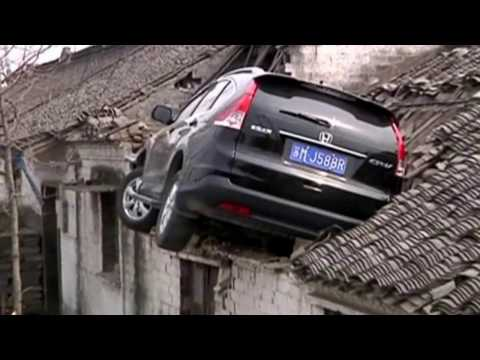 Car gets struck on the Roof of the House – CCTV Footage