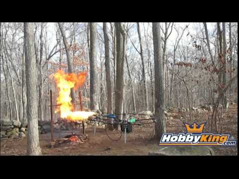 Quadrocopter With Flamethrower Roasting A Turkey