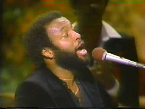 Crouch - Multi Gospel Grammy winner Andrae Crouch singing *Soon and Very Soon* at one of the