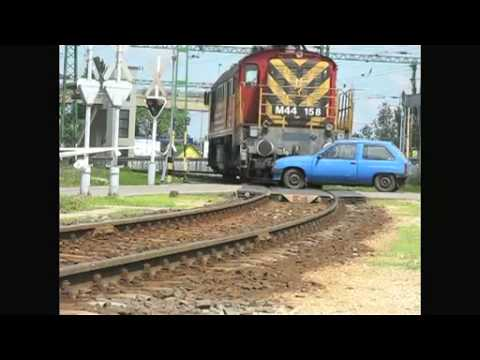 Diesel locomotive hits car in a level crossing