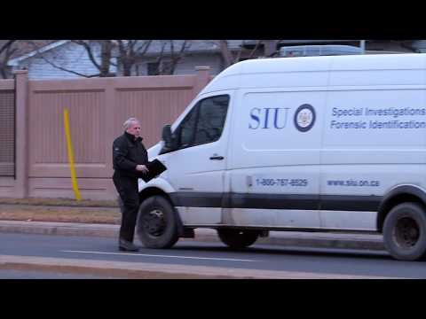 Freeze frame from video: SIU Investigators