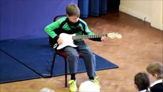 Junior Lunchtime Concert featuring Year 5, T Bunkle, on the Electric Guitar